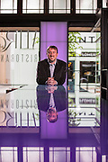Environmental portrait of Fayetteville architect Tim Maddox with DeMX Architecture standing in Vetro 1925 in Fayetteville, Arkansas.