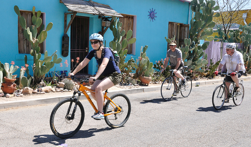 Bicycling trio passes by blue house during Cyclovia Tucson 2011. Bike-tography by Martha Retallick.