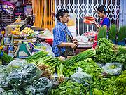 21 OCTOBER 2014 - BANGKOK, THAILAND:  A vegetable vendor in the Pak Khlong Talat market on the Chao Phraya River in Bangkok.   PHOTO BY JACK KURTZ