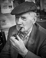 Old Man with a Pipe at the Village Store in Ballyvaughan. Image taken with a Leica X2 camera.