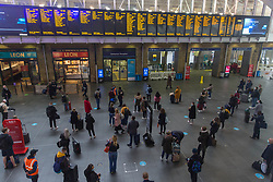 © Licensed to London News Pictures.  08/05/2021. London, UK. Passengers at Kings Cross Station in Central London. Trains to Edinburgh, Newcastle, York, Peterborough and Doncaster from Kings Cross have been cancelled due to major disruption. London North Eastern Railway have advised that 'do not travel' on the entire LNER network due to 'a problem under investigation'. LNER released a map of alternative connections from different London's station.  Photo credit: Marcin Nowak/LNP