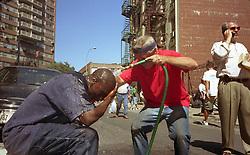 Sept. 11, 2001 - New York, New York, U.S. - A rescue worker has dust washed off him at a triage center near the Manhattan Bridge..(Credit Image: © Robert Gallagher/ZUMAPRESS.com)
