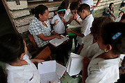 A teacher conducts class outside her classroom at the Escuela Republica del Mexico school in Guaimaca, Honduras.  Over 94% of Honduran children are enrolled in school, yet only 40% actually complete their schooling.  Hounduras is considered the third poorest country in the Western Hemisphere (Haiti, Nicaragua). With over 50% of the population living below the poverty line and 28% unemployed, Hondurans frequently turn to illegal immigration as a solution to their desperate situation. The Department of Homeland Security has noted an 95% increase in illegal immigrants coming from Honduras between 2000 and 2009, the largest increase of any country.