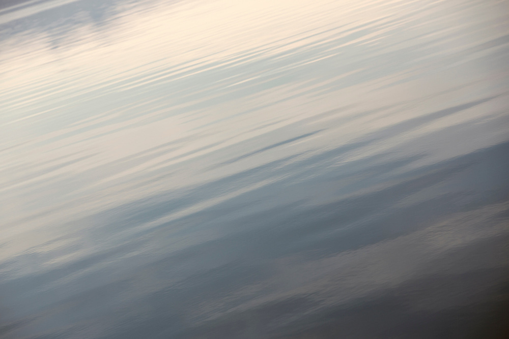 pastel colored water in diagonal lines calm the viewer - photographed by tracie spence