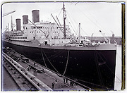 passenger ocean liner ship moored in harbor 1930s