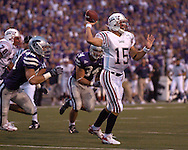 Florida Atlantic quarterback Sean Clayton (15) passes down field, as pressure from Kansas State defensive end Ian Campbell (98) comes from behind in the first half, at Bill Snyder Family Stadium in Manhattan, Kansas, September 9, 2006.  The Wildcats beat the Owls 45-0.