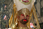 A man in ecclesiastical headgear and bright makeup.
