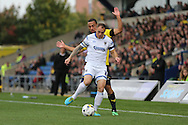 AFC Wimbledon defender Barry Fuller (2) holds the ball up during the Sky Bet League 2 match between Oxford United and AFC Wimbledon at the Kassam Stadium, Oxford, England on 10 October 2015.