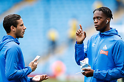"""Huddersfield Town's Ramadan Sobhi (left) and Terence Kongolo before the Premier League match at the Etihad Stadium, Manchester. PRESS ASSOCIATION Photo. Picture date: Sunday August 19, 2018. See PA story SOCCER Man City. Photo credit should read: Martin Rickett/PA Wire. RESTRICTIONS: EDITORIAL USE ONLY No use with unauthorised audio, video, data, fixture lists, club/league logos or """"live"""" services. Online in-match use limited to 120 images, no video emulation. No use in betting, games or single club/league/player publications."""