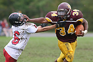 Kennedy Catholic's Lee Plotts stiff arms Lakeview's Mike Miller during a second quarter run at Butala Stadium in Hermitage, Pennsylvania.