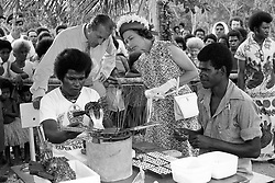 The Queen and the Duke of Edinburgh take a close interest in one of the local skills - the seeding of oysters - at Milne Bay during the Silver Jubilee visit to Papua New Guinea.