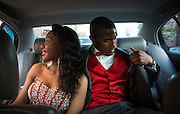 Jerlan Payne says goodbye to family and friends as date Alex Watt checks for their prom tickets as they depart their send-off party Friday, May 23, 2014 in Bronzeville. (Brian Cassella/Chicago Tribune) B583716573Z.1 <br /> ....OUTSIDE TRIBUNE CO.- NO MAGS,  NO SALES, NO INTERNET, NO TV, CHICAGO OUT, NO DIGITAL MANIPULATION...