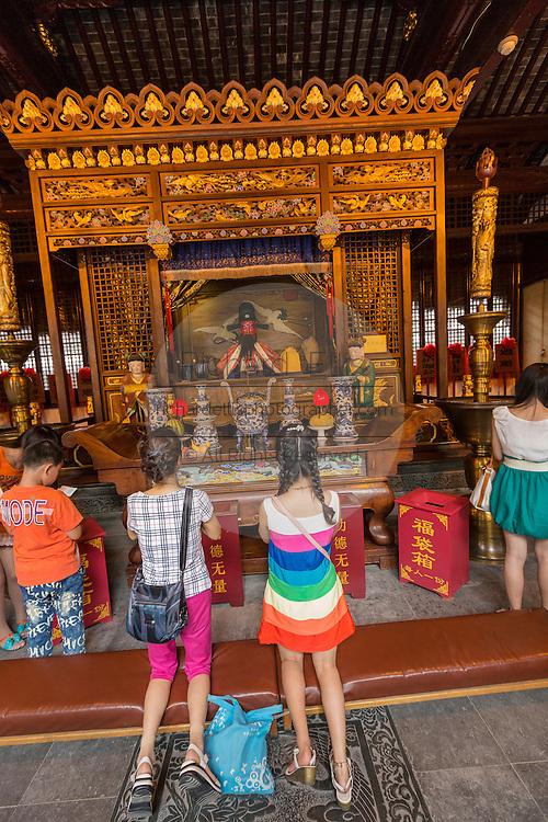 People pray at Chenghuang Miao or City God Temple in Yu Yuan Gardens bazaar Shanghai, China