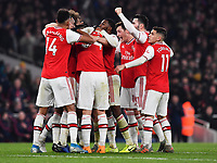 Football - 2019 / 2020 Premier League - Arsenal vs. Manchester United<br /> <br /> Arsenal's Sokratis (hidden) celebrates scoring his side's second goal, The Emirates Stadium.<br /> <br /> COLORSPORT/ASHLEY WESTERN
