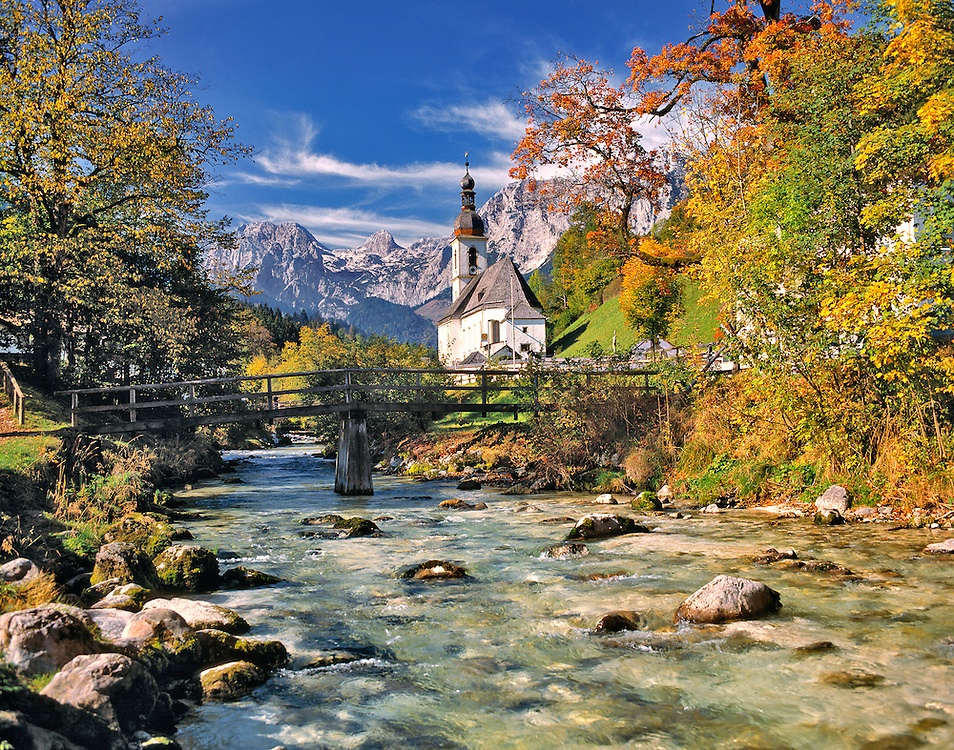 The fall foliage adds to the beauty of this small church in Ramsau near Berchtesgaden, Bavaria, Germany.