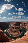 The sun creates a star shape above Horseshoe Bend outside of Page, Arizona. Missoula Photographer