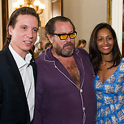 """Patrick Marinoff (CEO Maybach) (L) Julian Schnabel (C) and Rula Jebreal (R) at the press preview of Julian Schnabel - """"Permanently Becoming And The Architecture Of Seeing"""" part of 54th International Art Biennale in Venice"""