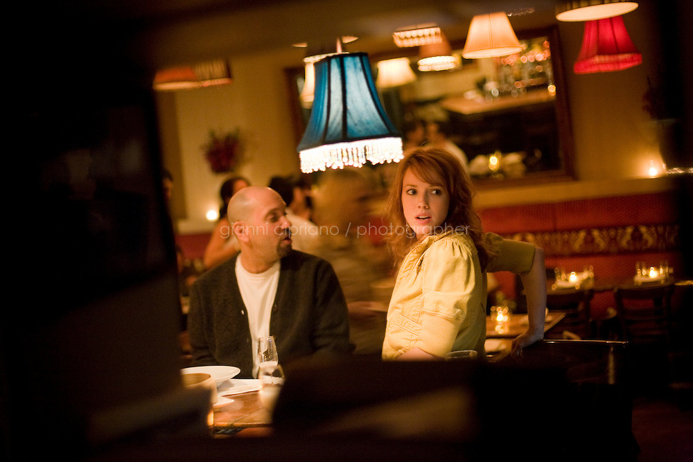 9 October, 2008. New York, NY. General manager Balke Davis (right) and manager Antonio have late dinner after midnight at Shorty's 32 Restaurant in Soho. Shorty's 32 has late night services some nights. <br /> <br /> ©2008 Gianni Cipriano for The New York Times<br /> cell. +1 646 465 2168 (USA)<br /> cell. +1 328 567 7923 (Italy)<br /> gianni@giannicipriano.com<br /> www.giannicipriano.com