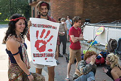 Young environmental activists from HS2 Rebellion wait with supporters before attending a hearing at High Wycombe Magistrates Court on 10th August 2020 in High Wycombe, United Kingdom. Seven, mainly teenage activists, appeared in court after having been arrested whilst standing on a bridge on a public footpath in Denham Country Park by police officers using the Trade Union and Labour Relations Act.