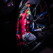 Leg 3, Cape Town to Melbourne, day 03, Willy Altadill moving stack down below on board MAPFRE. Photo by Jen Edney/Volvo Ocean Race. 12 December, 2017.