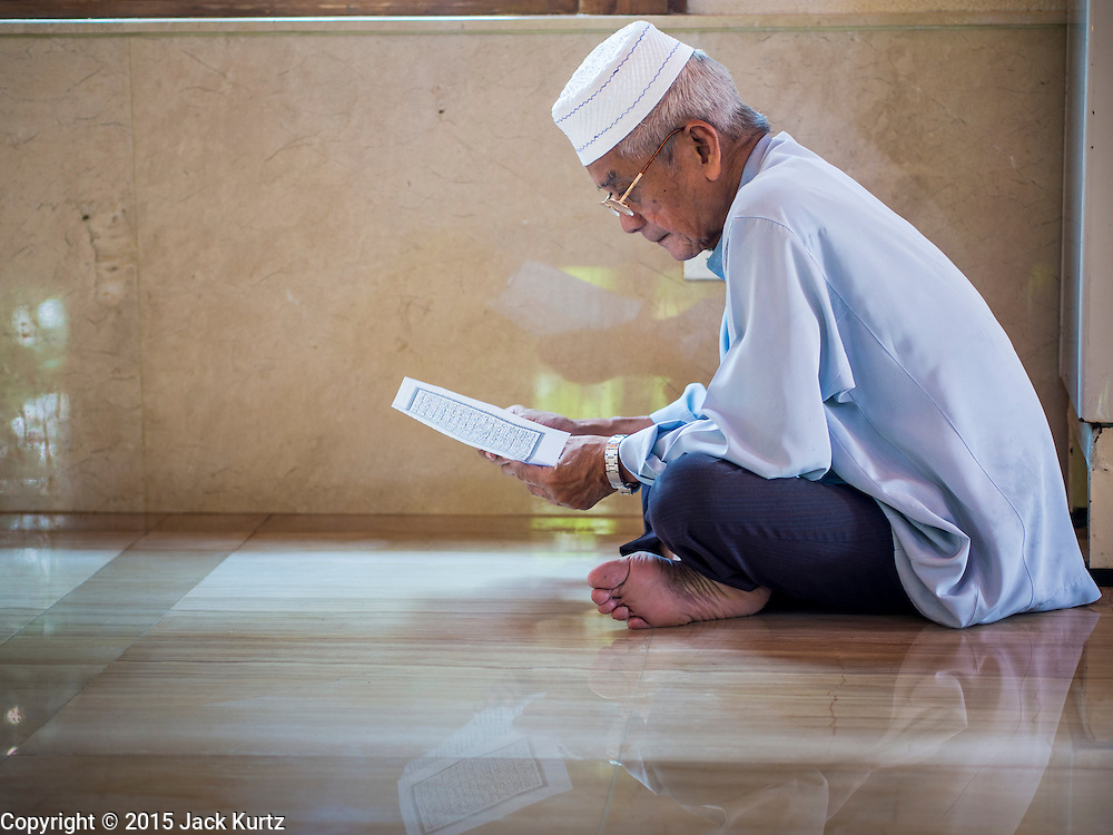 10 APRIL 2015 - BANGKOK, THAILAND: A man prays in Masjid Ton Son in Bangkok. (Masjid is the Thai word for Mosque.) A Pew Research Center study recently released identified Islam as the fastest growing religion in the world. Masjid Ton Son was the first mosque in Bangkok, founded in 1688 during the reign of King Narai, of the Ayutthaya era. Muslims are about 5 percent of Thailand, but make up a bigger proportion of Bangkok. Thailand's deep south provinces are Muslim majority.    PHOTO BY JACK KURTZ