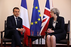 File photo dated 26/05/17 of French President Emmanuel Macron speaking with Prime Minister Theresa May. Social media companies such as Facebook and Twitter could be fined if they fail to remove extremist propaganda and terrorist material under proposals agreed by the Prime Minister and French President.