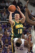 North Dakota State guard Ben Woodside (10) is called for the charge while taking the shot over Kansas State's David Hoskins (15) in the first half, during K-State's 82-56 win over North Dakota State at Bramlage Coliseum in Manhattan, Kansas, January 2, 2006.