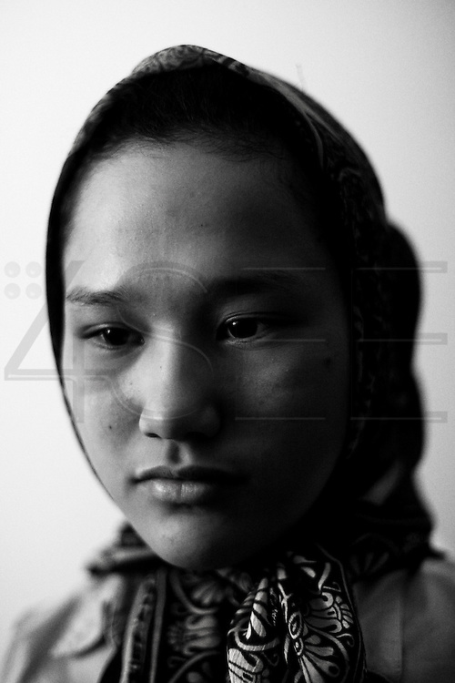 Athens, Greece - Mohadisa, 12, Afghan refugee. The day she decided to enroll in school, she was attacked and insulted by a group of far-right extremists, who stripped her off her veil. She never went back to study. In Greece, the deep recession due to the Austerity Measures imposed by the Troika (European Union, European Central Bank, and International Monetary Fund) caused the worsening in life conditions of both the native population and the immigrant one. The latter had to face not only an enormous increase of poverty and unemployment -often leading to homelessness- but also the rise in popularity of Golden Dawn, an ultranationalist party which got 18 seats in Parliament after June 2012 election. G.D. propaganda and actions are all based on racism and hate towards the foreign communities, blamed to be one of the main causes of the crisis. <br /> Bruno Simões Castanheira