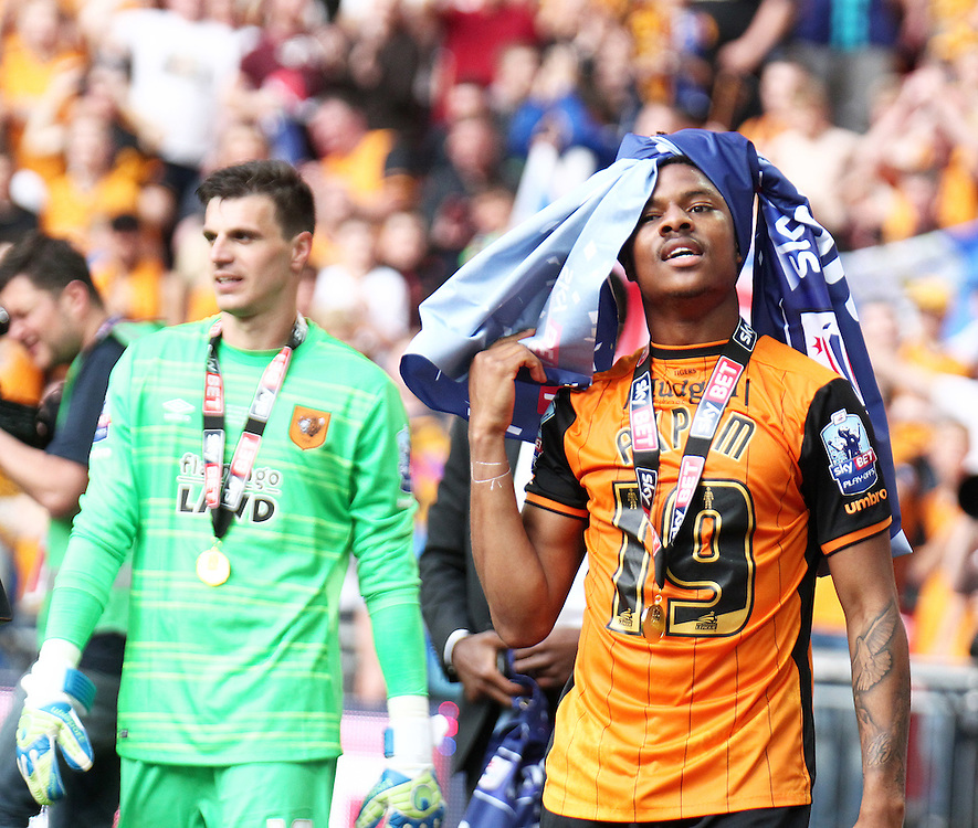 Hull City's Chuba Akpom celebrates winning promotion to The Premier League<br /> <br /> Photographer Rich Linley/CameraSport<br /> <br /> Football - The Football League Sky Bet Championship Play-Off Final - Hull City v Sheffield Wednesday - Saturday\ref 28th May 2016 - Wembley Stadium - London<br /> <br /> World Copyright © 2016 CameraSport. All rights reserved. 43 Linden Ave. Countesthorpe. Leicester. England. LE8 5PG - Tel: +44 (0) 116 277 4147 - admin@camerasport.com - www.camerasport.com