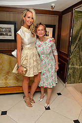 "Left to right, LADY VICTORIA HERVEY and her mother YVONNE, MARCHIONESS OF BRISTOL at a party to celebrate the publication of ""Lady In Waiting: The Wristband Diaries"" By Lady Victoria Hervey held at The Goring Hotel, Beeston Place, London on 9th May 2016."