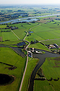 Nederland, Gelderland, Gemeente Heerde, 03-10-2010; Wapenveld, het gemaal Pouwel Bakhuis voert overtollig water van de Veluwe af naar de IJssel. Het stoomgemaal (met rood pannendak) is door een modern gemaal vervangen. .The pumping station Pouwel Bakhuis carries excess water away from the Veluwe to the river IJssel. The steam pumping station (with red tile roof) is replaced by a modern pumping station..luchtfoto (toeslag), aerial photo (additional fee required).foto/photo Siebe Swart