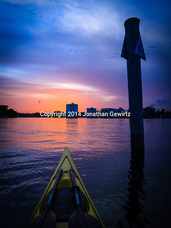 A beautiful sunset over Miami, Florida as seen from a kayak in Biscayne Bay.<br /> <br /> WATERMARKS WILL NOT APPEAR ON PRINTS OR LICENSED IMAGES.
