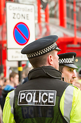 Police monitor demonstrators at the Anti Cuts rally during the Liberal Democrats conference in Sheffield
