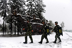 August 28, 2017 - Mohe, Mohe, China - Mohe, CHINA-28th August 2017: (EDITORIAL USE ONLY. CHINA OUT)..Soldiers patrol at the Mohe Village after the arrival of the August snow in northeast China's Heilongjiang Province, August 28th, 2017. (Credit Image: © SIPA Asia via ZUMA Wire)