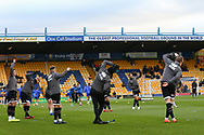 Grimsby Town players warm up during the EFL Sky Bet League 2 match between Mansfield Town and Grimsby Town FC at the One Call Stadium, Mansfield, England on 4 January 2020.