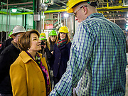 12 APRIL 2019 - NEVADA, IOWA: US Senator AMY KLOBUCHAR, (D-MN) talks to a worker at Lincolnway Energy during a tour of the Lincolnway Energy ethanol plant in Nevada, IA. Sen. Klobuchar is touring Iowa this weekend to support her bid for the Democratic nomination of for the US Presidency. Iowa traditionally hosts the the first election event of the presidential election cycle. The Iowa Caucuses will be on Feb. 3, 2020.          PHOTO BY JACK KURTZ