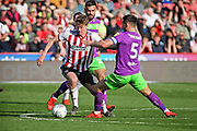 Sheffield Utd midfielder Kieran Dowell (8) taking on Bristol City defender Bailey Wright (5) during the EFL Sky Bet Championship match between Sheffield United and Bristol City at Bramall Lane, Sheffield, England on 30 March 2019.