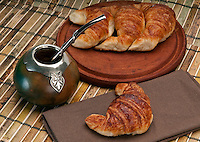 Cup of calabash and Croissants, this is a typical drink and breakfast in Argentine. Use of selective focus.