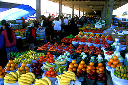 Stock photo of people buying fresh fruit and other produce at the farmer's market in downtown Houston Texas