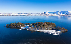 Kinross, Scotland, UK. 11 Feb 2021. Aerial view of a snow covered Loch Leven Castle situated on small island on Loch Leven, Kinross-shire.  Iain Masterton/Alamy Live news