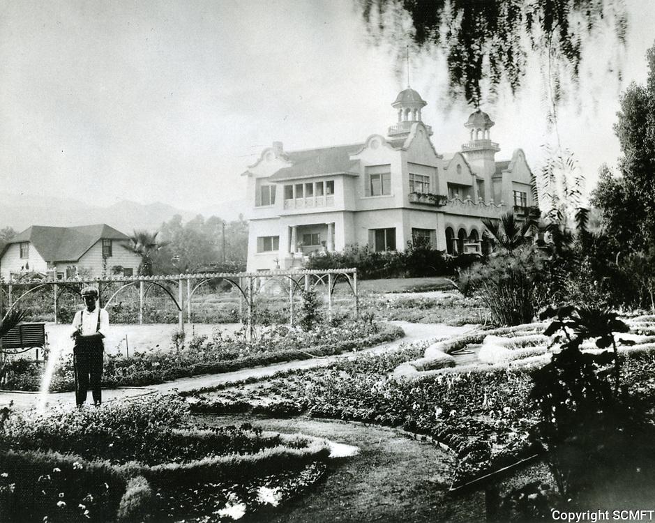 1905 Paul DeLongpre in his garden