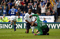 Photograph: Scott Heavey.<br />Leicester City v Tottenham Hotspur. 19/10/2003. FA Barclaycard Premiership.<br />Kasey Keller thumps the ground as Paul Dickov celebrates