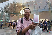 Sho Inowe poses with his new iPhone 7 at the launch of the iPhone 7 and iPhone 7 plus at the Apple store in Omotesando, Tokyo, Japan. Friday September 16th 2016. The iPhone launches are global events. Around 200 eager customers waited outside the Apple store in Tokyo, some for several days, to be first in line to buy the new product.