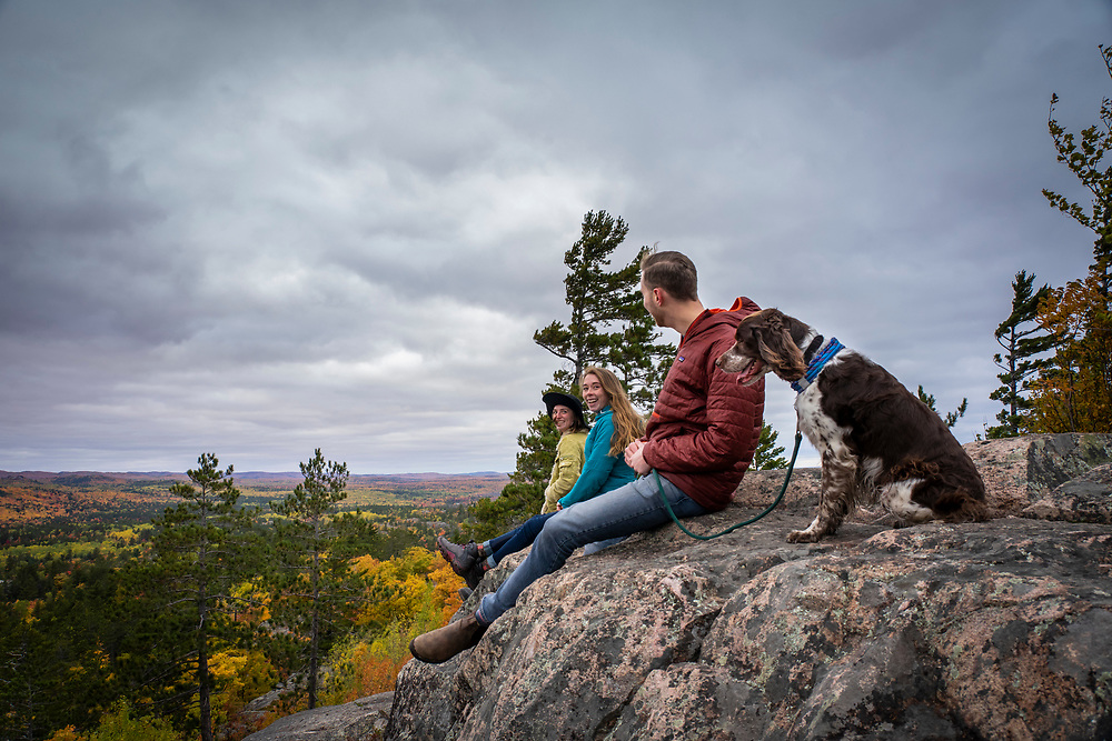 Hiking Sugarloaf Mountain Marquette Michigan in fall.