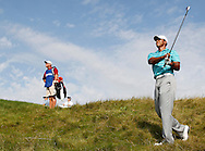 Tiger Woods watches his approach shot to the 15th hole during the second round of the 92nd PGA Championship at Whistling Straits in Kohler, Wisconsin on August 14, 2010. Half of the players finished their second rounds Saturday after play was suspended Friday due to darkness. (UPI)