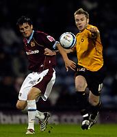 Photo: Jed Wee/Sportsbeat Images.<br /> Burnley v Hull City. Coca Cola Championship. 06/11/2007.<br /> <br /> Hull's Steve McPhee (R) takes on Burnley's Stephen Jordan.