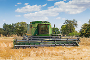 John Deere 9610 combine harvester after cutting the last of the wheat crops as the harvest season comes to an end near Toogong, New South Wales, Australia <br /> <br /> Editions:- Open Edition Print / Stock Image
