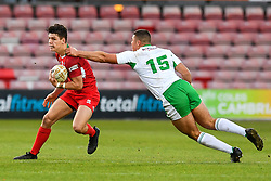11th November 2018 , Racecourse Ground,  Wrexham, Wales ;  Rugby League World Cup Qualifier,Wales v Ireland ; Josh Ralph of Wales evades the tackle of Ronan Michael of Ireland <br /> <br /> <br /> Credit:   Craig Thomas/Replay Images