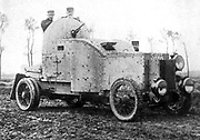 Belgian armoured personnel carrier fitted with a gun turret on the roof, c1914.  The armour has been constructed round a production car.