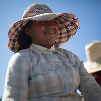 A young woman in a sun hat working on a coffee farm for the COMSa coop, Marcala, Honduras